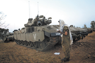 An Israeli soldier prays near the Gaza border Tuesday morning.