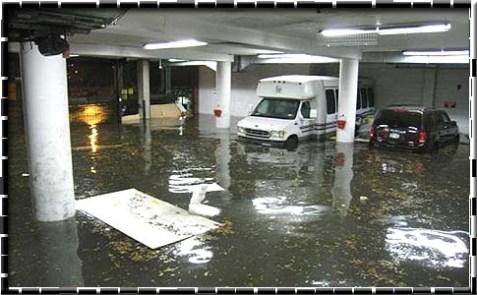 Parking garage downtown under water.