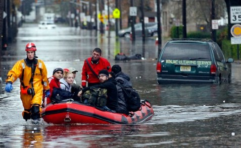 Emergency personnel rescue residents from flood waters brought on by Hurricane Sandy in Little Ferry