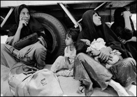 Palestinian refugees at Kuwaiti border waiting to be deported, 1991.