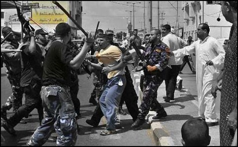 Hamas security officials using batons to detain Fatah supporters during clashes in Gaza City on Sept. 7, 2007.