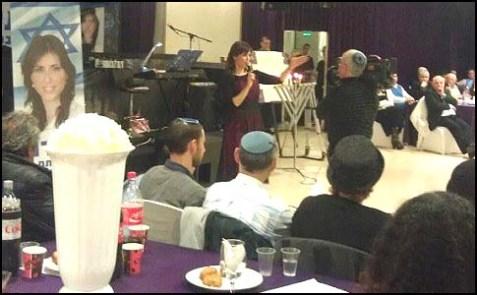 Likud MK Tzipi Hotovely speaking to supporters.