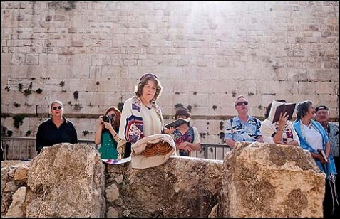 Anat Hoffman of the Women of the Wall reads from the Torah at Robinson's Arch outside of the Western Wall.