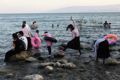 Children exploring Lake Kinneret in 2012.