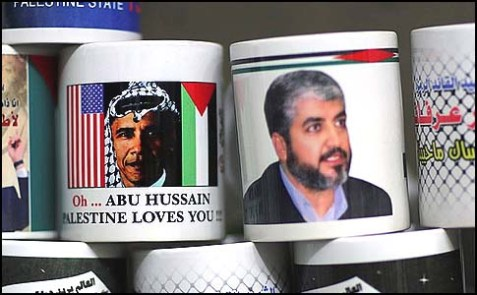 If mugs could talk: Hamas hero Mashaal (R) shares a mug stand in a Gaza market with another Palestinian hero, Abu Hussain, as he is identified on the mug bearing his re-attired image.