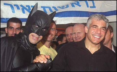 Yair Lapid (pictured with a friend) was the big winner Friday morning, capturing votes from both Likud-Beiteinu and Labor.
