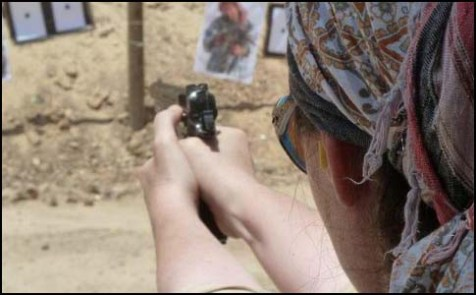 The Jewish Press Online's Malkah Fleisher training at the Caliber 3 gun range.