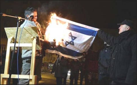 Hungarian MP Lenhardt Balazs Burning an Israeli Flag.