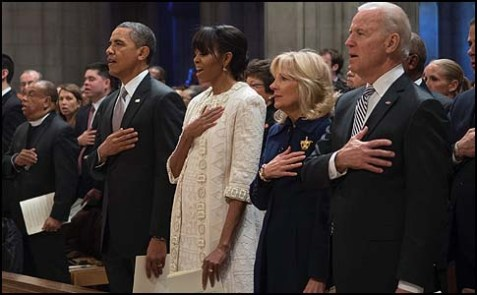 The Obamas and Bidens during the singing of the National Anthem at the National Cathedral.
