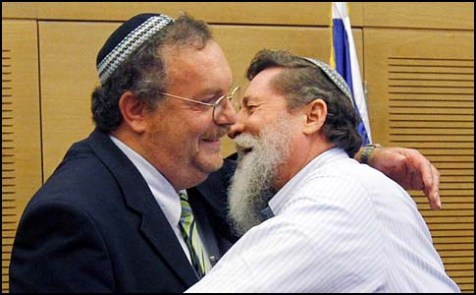 MKs Daniel Hershkowitz (L) Yaakov Katz hugging, back in 2010, after the announcement of the founding of the new Jewish Home party.