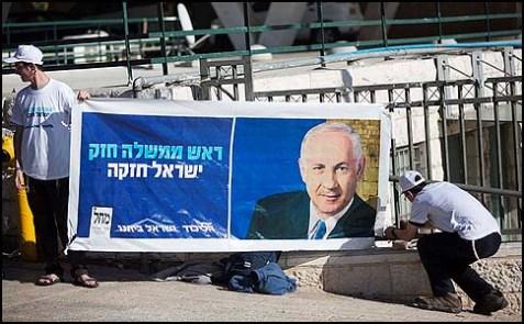Likud activists putting up a large election poster, December 27, 2012.