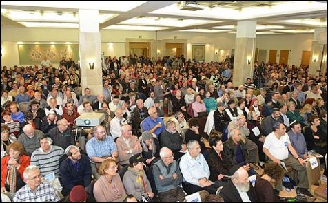 Despite the late change to a larger venue, the conference was standing room only.