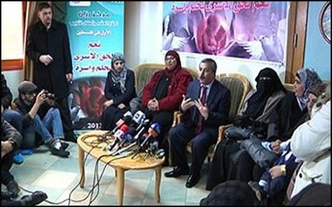 Dr Salem Abu Khaizaran at a press conference Thursday with the happy recipients.