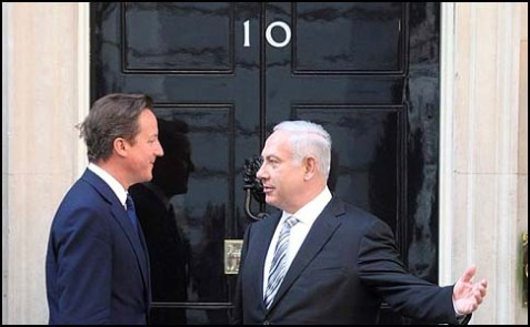 British Prime Minister David Cameron with a friend outside 10 Downing Street.