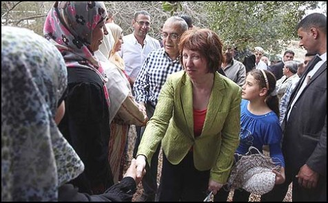 EU foreign policy chief Catherine Ashton and Palestinian Prime Minister Salam Fayyad with Palestinian farmers in the Judea and Samaria village of Ras Karkar near Ramallah, October 25, 2012.