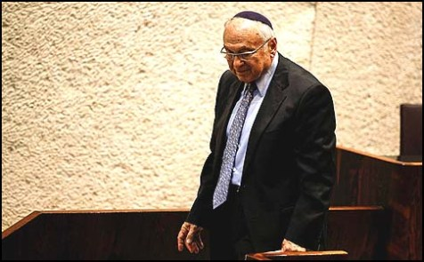 "Justice Minister Yaakov Ne'eman getting off the podium after being pummeled by MKs on ""Prisoner X"" affair."