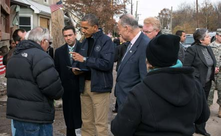 Senator Charles Schumer (D-NY) standing next to President Barack Obama during a walking tour of damage caused by Hurricane Sandy in Staten Island Nov. 15, 2013.