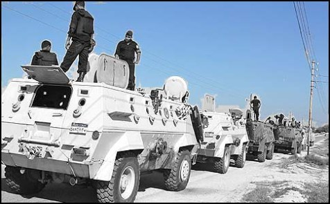 Egyptian security forces stand by their Armored Personnel Carriers ahead of a military operation in the northern Sinai peninsula.