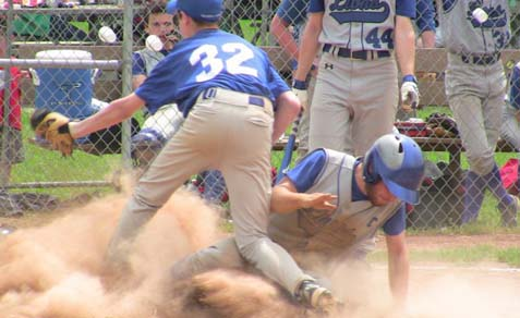 Samuel Rosenstein, of Columbus Torah Academy, sliding into home plate.