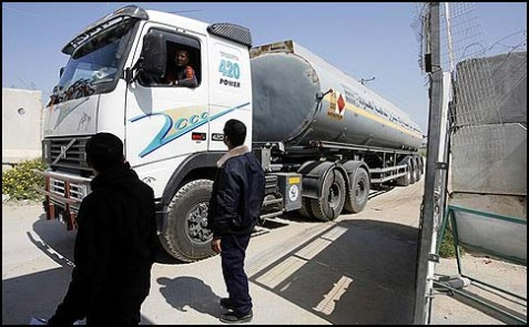 Hamas security officers checking a tanker in Rafah town after entering through the Kerem Shalom crossing between Israel and the southern Gaza Strip.
