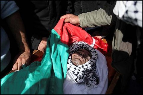 The body of Arafat Jaradat during his funeral in the village of Se'eer, near Hebron, February 25, 2013.