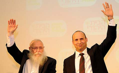 Naftali Bennett, leader of the Jewish Home party, with Rabbi Haim Drukman, celebrating the party's entry into government. Rabbi Drukman blamed the Haredim for their being blocked from joining the coalition.