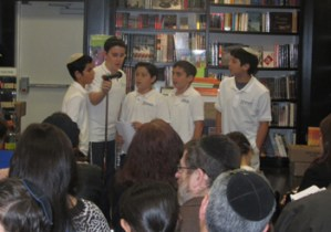 Sixth-grade boys (L-R) Eitan Tabul, Jack Benveniste-Plitt, Sam Klein, Joseph Abrahams, and Noah Dobin present a poem in Hebrew.