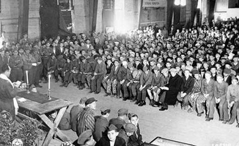 Rabbi Herschel Schacter conducting a Passover seder in the Buchenwald concentration camp.