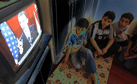 Palestinian boys listen to President Barack Obama&#039;s speech at Cairo University.