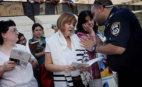 "Lesley Sachs, director of ""Women of the Wall"" being told by police to remove her talit."