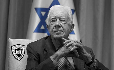 Jimmy Carter in front of the Israeli flag, which proves that he knows how to be photographed.