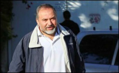 Foreign Minister Avigdor Liberman leaves his house at the settlement of Nokdim at the moment after he resigned from his duty.