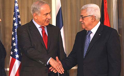 Prime Minister Benjamin Netanyahu shaking hands with President Mahmoud Abbas.