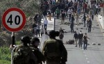 Arab rioters hurling rocks at Israeli soldiers during clashes in the village of Aboud, near Ramallah, March 8, 2013.