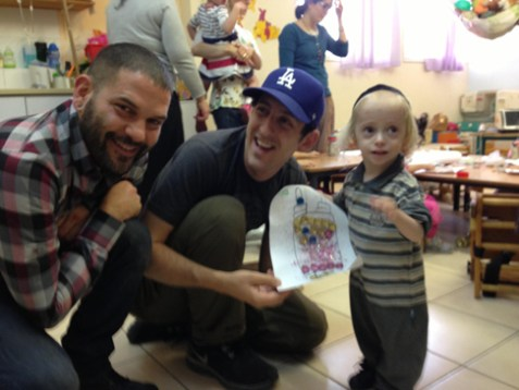 Guillermo Diaz (left) and Adam Shapiro (center) at MESHI in Jerusalem, a community outreach center that assists severely disabled children. (Photo by AVI)