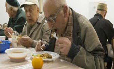 Holocaust survivors at Chabad soup kitchen in Israel