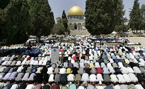 Muslims pray in front of the Dome of the Rock on the Temple Mount