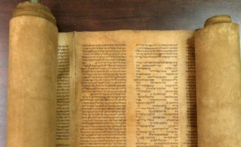 An ancient Torah scroll (illustrative).