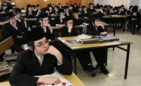 Ultra Orthodox Jewish youths studying religious texts at a Yeshiva in Jerusalem.