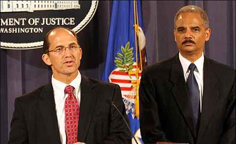 Sean Joyce, left, Deputy director of the FBI, and Attorney General Eric Holder, during a press conference at the Department of Justice.