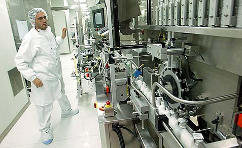 A Teva systems engineer watching over the packaging line of pharmaceuticals at the Jerusalem factory. A possible system failure in the French factory may have caused several deaths and hospitalizations.