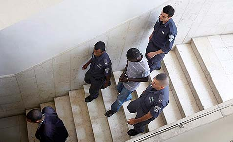 A rape suspect is brought to the District court in Jerusalem.