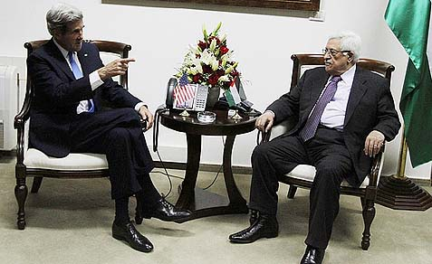 Secretary of State John Kerry (L) seen with PA President Mahmoud Abbas.