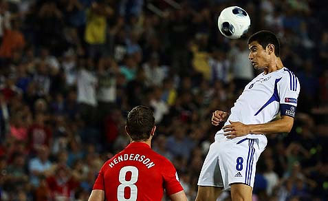 Nir Bitton from Israel in action against England's Jordan Henderson during the UEFA European U21 Championships, Group A match between Israel and England at Teddy Stadium in Jerusalem, June 11, 2013.