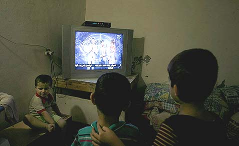 Arab kids watching singer Mohammed Assaf on TV in the Rafah refugee camp, southern Gaza.