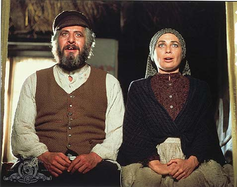 Chaim Topol as Tevye, and Norma Crane as his wife, Golde.