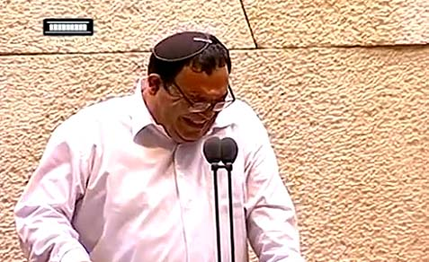 Education Minister Shai Piron (Yesh Atid) laughing uncontrollably.
