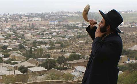 Rabbi Ovadia Isikoff, seen blowing a shofar against the background of his city, Derbent, Russia, was shot, most likely by an Islamist.