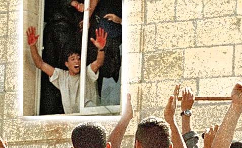 Arab Murderer showing off his bloody hands to the crowd out the window of the Ramallah police station where Israeli soldiers were lynched in October 2000.