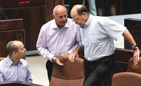 "Defense Minister Moshe 'Bogie' Ya'alon (R) with Minister of Economics Naftali Bennett (L) and Minister of Science Yaakov Perry, whose committee issued the original draft of the new ""equal burden"" military service bill."
